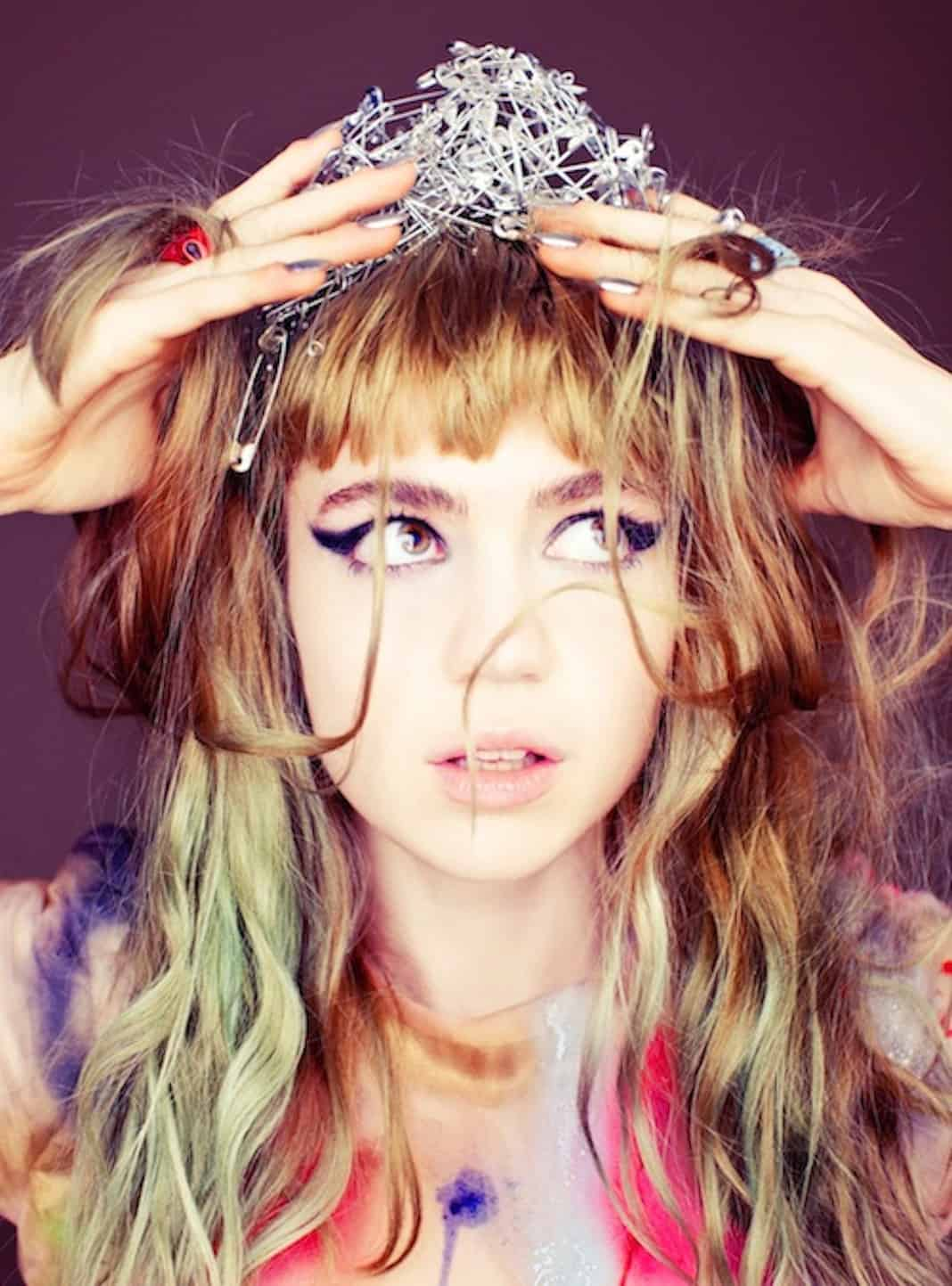 Grimes Debuts a New Video and Unreleased Song